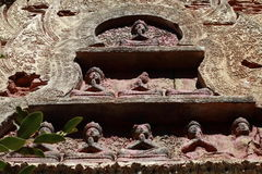 Asian temple. Detail of figures that decorate the facade of a Buddhist temple Stock Image