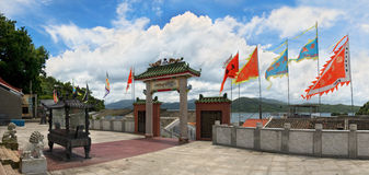 Asian temple entrance decorated with flags Royalty Free Stock Photo