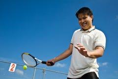 Asian tennis player. A shot of an asian tennis player hitting a tennis ball Royalty Free Stock Photo