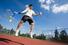 Asian tennis player. An asian tennis player jumping in the air hitting a tennis ball Royalty Free Stock Photos