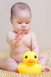 Asian thai baby girl playing with yellow duck royalty free stock photo