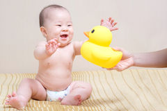 Asian thai baby girl playing with yellow duck Royalty Free Stock Photography