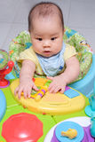 Asian thai baby play her colorful toy Royalty Free Stock Photography