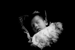 Asian Thai baby sleeping  low key black and white Royalty Free Stock Photos