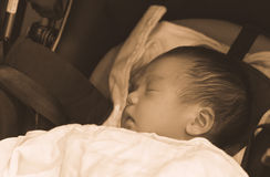 Asian Thai baby sleeping on stroller sepia Royalty Free Stock Images