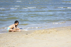Asian Thai boy playing sand Stock Photo
