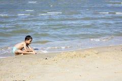 Asian Thai boy playing sand Stock Photo