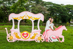 Asian Thai Bridal beside Love Carriage Stock Photo