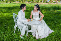 Asian Thai Bridal with Piece of Wedding Cake Stock Photos
