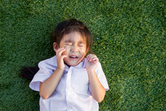 Asian Thai children crying on green grass Stock Image