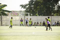 Asian thai children playing futsal in tournament at futsal pitch Royalty Free Stock Images