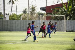 Asian thai children playing futsal in tournament at futsal pitch Royalty Free Stock Photo