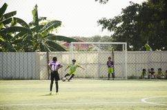 Asian thai children playing futsal in tournament at futsal pitch Royalty Free Stock Photography