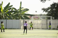 Asian thai children playing futsal in tournament at futsal pitch Royalty Free Stock Image
