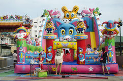 Asian thai children relax playing on inflatable playground or in stock images