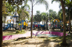 Asian thai children relax playing at modern colorful playground Royalty Free Stock Photography
