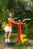 Asian Thai Girl with Exercise Machine in Public Park Royalty Free Stock Image