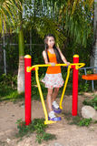 Asian Thai Girl with Exercise Machine in Public Park Royalty Free Stock Photo
