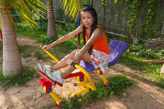 Asian Thai Girl with Exercise Machine in Public Park Stock Image