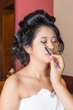 Asian Thai Girl Getting Eye Shadow on Eyelids Royalty Free Stock Image