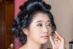 Asian Thai Girl Getting Eye Shadow on Eyelids Royalty Free Stock Photo