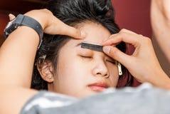 Asian Thai Girl Getting Eyebrow Shaped Stock Photos