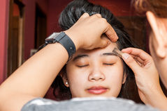 Asian Thai Girl Getting Eyebrow Shaped Royalty Free Stock Images
