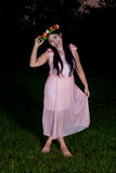 Asian Thai girl is holding flower crown in the park Royalty Free Stock Images
