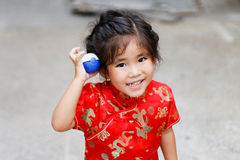 Asian Thai girl play pokemon ball. Close up asian thai girl smile play pokemon ball toy show funny action royalty free stock photo