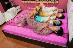 Asian Thai girls and boy sleep with turning face u Royalty Free Stock Photos