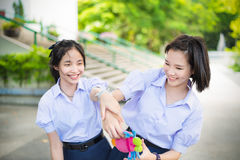 Asian Thai high schoolgirls student couple playing Stock Photo