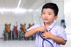 Asian Thai kid with medical stethoscope looking at camera, healt. Hy concept idea stock image
