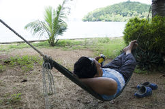 Asian thai man sleep and relaxing on furniture Hammock hanging b Stock Image