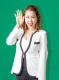 Asian thai model greeting action on greenscreen. Asian Thai business woman greeting happy action  on green screen Royalty Free Stock Images