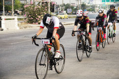 Asian thai people biking bicycle in race on street highway with traffic road Stock Photo