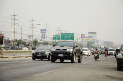 Asian thai people biking bicycle in race on street highway with traffic road Stock Photography