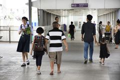 Asian thai people and foreigner passengers walking in terminal of MRT Stock Image