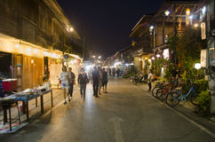 Asian thai people and foreigner travelers visit travel and walking shopping on street night market at Chiang Khan Stock Photo