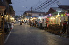 Asian thai people and foreigner travelers visit travel and walking shopping on street night market at Chiang Khan Stock Photos