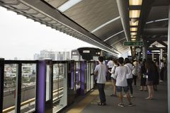 Asian thai people and foreigner travelers waiting journey by MRT Stock Photography