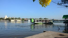 Asian thai people passenger by Ferry boat across Mae klong river go to work in morming at Mae klong station port stock video footage