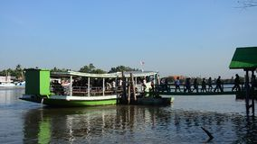 Asian thai people passenger by Ferry boat across Mae klong river go to work in morming at Mae klong station port stock footage