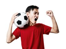 Asian Thai people soccer fan football in red sleeve shirt isolated on white. royalty free stock photo