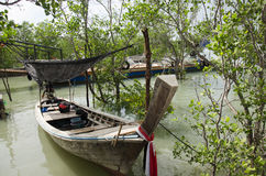 Asian thai people stop wooden fishing boat under tree on the sea Stock Images