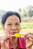 Asian Thai woman eating ice cream Stock Image