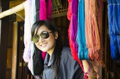 Asian thai woman travel and posing with colorful thread silks Stock Image