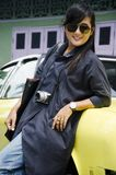 Asian thai woman travel and posing with retro yellow classic car. At parking for show people and traleiers in antique town on June 8, 2017 in Nonthaburi Royalty Free Stock Photography