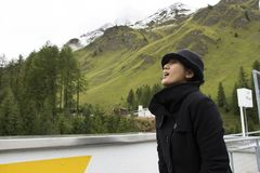 Asian thai woman travel and posing for take photo with Alps mountain at petrol station Royalty Free Stock Images