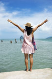 Asian thai woman traveling and posing at harbour with sea and sk Royalty Free Stock Photos