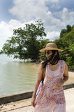 Asian thai woman traveling and posing at harbour with sea and sk Stock Images